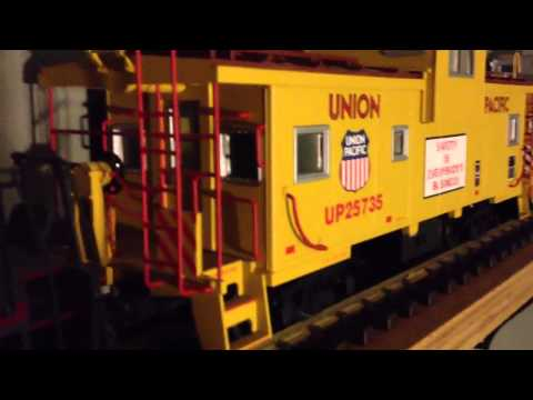G-scale locomotive and caboose look at.