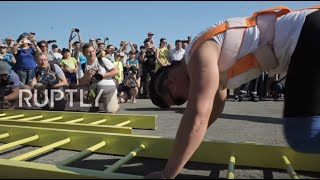 Russia: Nation's strongest woman pulls eight-tonne helicopter at air show