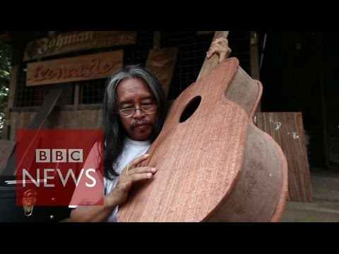 Myanmar man makes guitars from Cyclone Nargis wood - BBC News