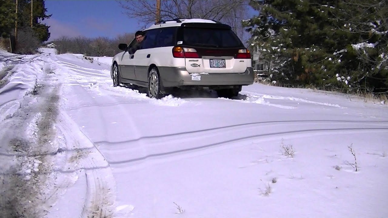 subaru outback spinning tires  snow youtube
