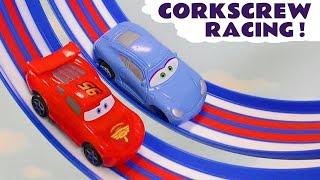 Cars 3 Hot Wheels Corkscrew with DC Comics & Marvel Avengers 4 vs Disney Pixar McQueen Race Off