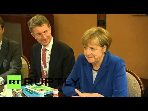 Italy: See Putin and Merkel talk Ukraine over breakfast at ASEM