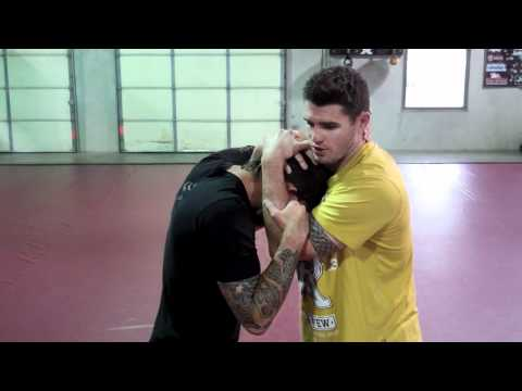 How to Enter the Clinch and Throw Knees - MMA & Muay Thai Image 1