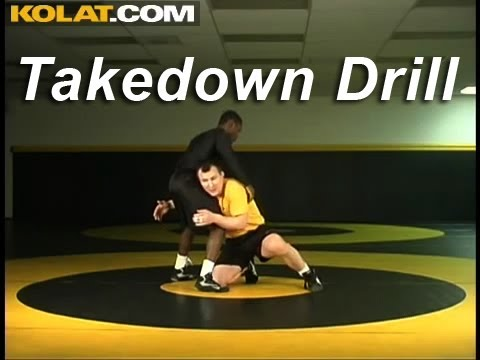 Takedown Drill KOLAT.COM Wrestling Techniques Moves Instruction Image 1