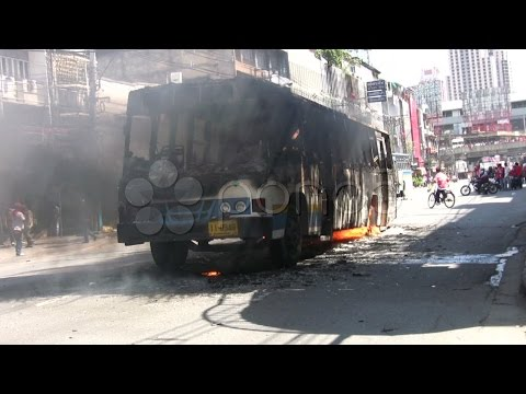 Burning Bus In Riot Street Civil War Protest Demonstration Red Shirt Thailand . Stock Footage