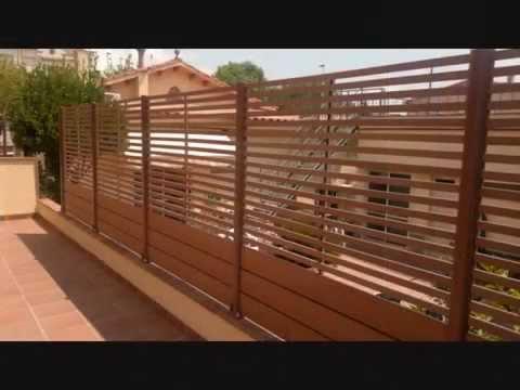 Vallas y puertas de madera de exterior sintetica o natural for Puertas de madera exterior precios