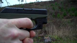 Ruger LCP .380 pistol with Crimson Laser  at the range