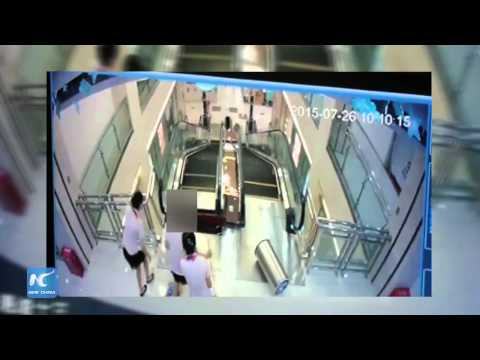 Chinese woman saves son before falling into escalator