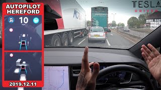 Tesla Autopilot in a UK City #1 - Can it navigate 4 lanes & drivers cutting in traffic?! (Hereford)