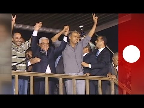 Celebrations as freed Palestinian prisoners are welcomed back by their families