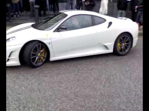 White Ferrari 430 Scuderia accelerating