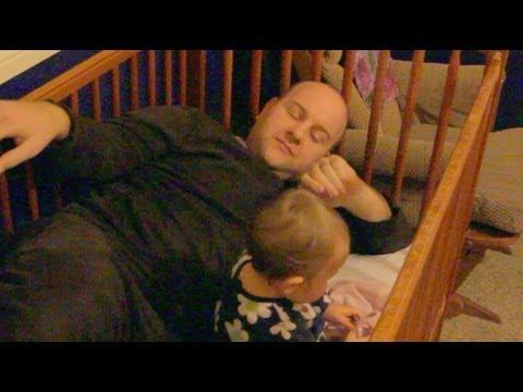 Dad climbs into baby crib!