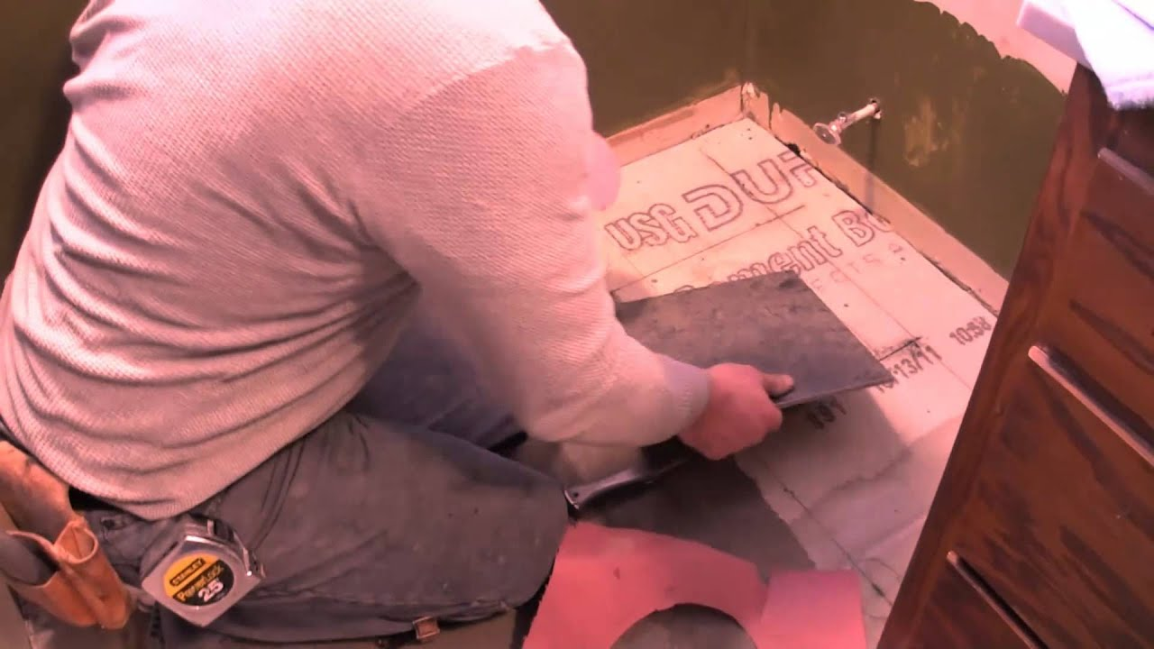How to Cut Porcelain Tile around the Toilet Flange - Marking the Tile - YouTube