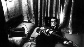 Watch Elvis Costello Strange video