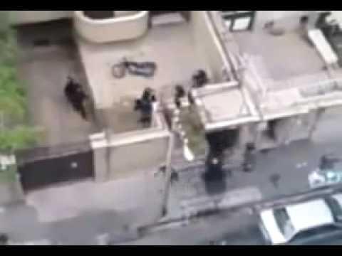 Police beating people in their home yard 14 June 2009 Tehran Iran