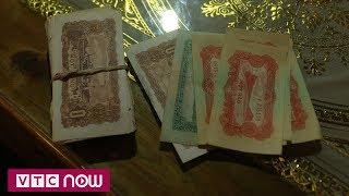 Dọn nhà, phát hiện hàng trăm tờ tiền cách đây nửa thế kỷ