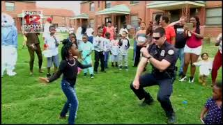 Chattanooga police officer dancing at East Lake Courts