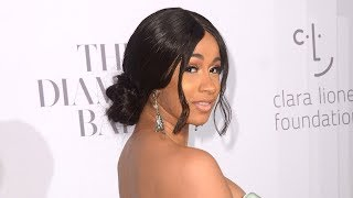 Cardi B STUNS In Princess Gown Equipped With Its Own Team At Diamond Ball
