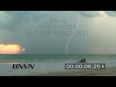 8/28/2007 Lightning Bolts strike as people watch on the storm on a beach