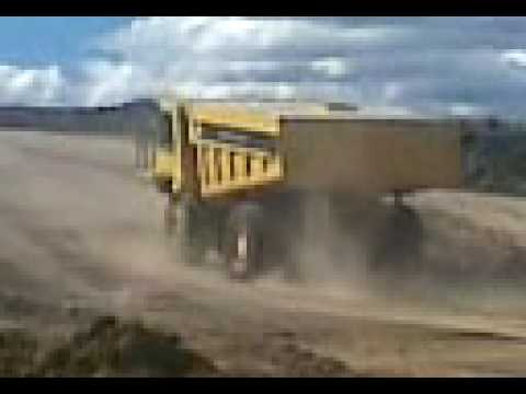 HUGE dump truck / water cart at tip