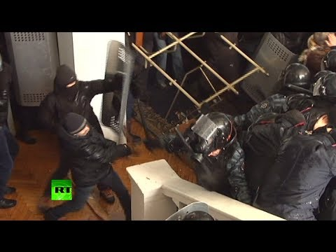 Violent video: Ukraine rioters brutally beat police, storm local admin building