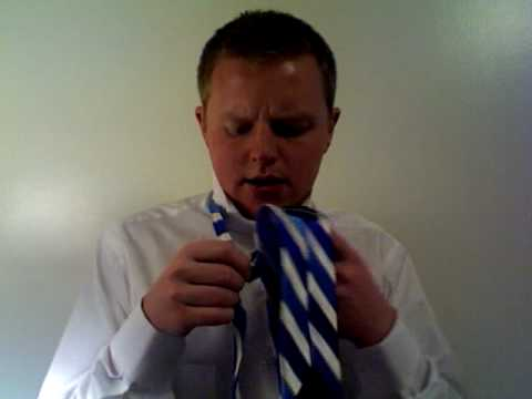how to tie tie step by step. How to Tie a Tie | Full Windsor Knot Instructional Video. 2:19. www.Tiepedia.com - Learn how to tie a tie quickly and easily with this step by step video.