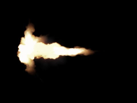 machine gun muzzle flashes