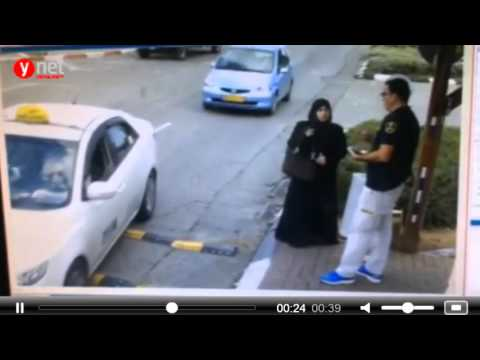 Palestinian women attacking a  security guard with her knife, Betar-illit, israel [November 8 2015]