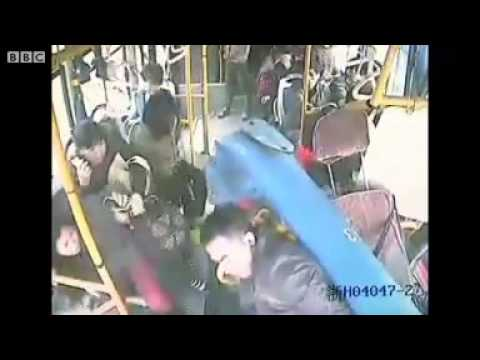 Chinese bus driver survives after being hit by lamp post.