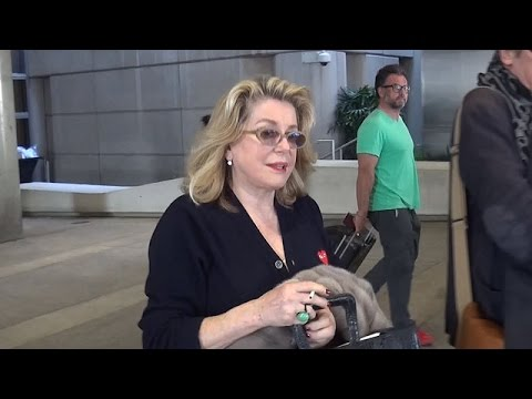 Catherine Deneuve Corrects At LAX: 'I'm Not Married'