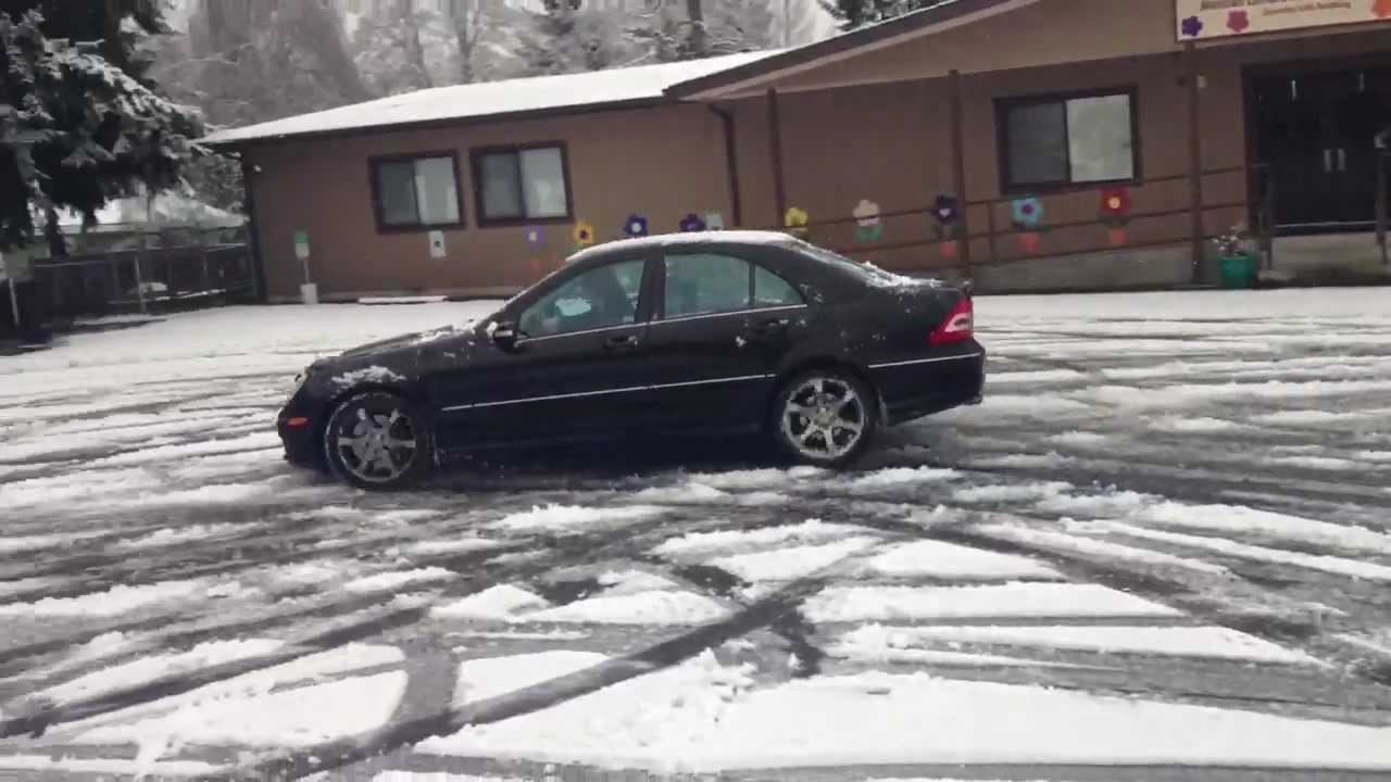 Mercedes c230 sport and bmw 328i drifting in snow wit for Mercedes benz snow chains