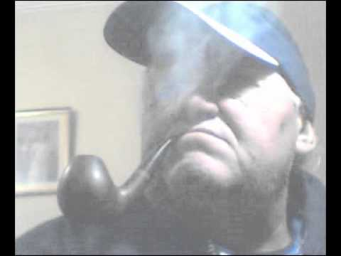 "Smoker, of Karl Erik Compact, Pipe, Curved, with Dark Blue White Hat; and "" Amarcord ""."