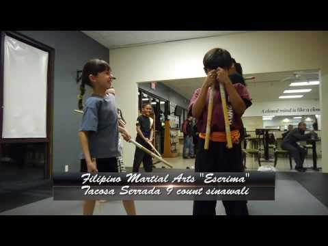 Kids martial arts classes - learning Escrima techniques called sinawali Image 1