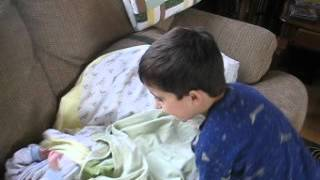 Jason Zeena putting a blanket on little brother
