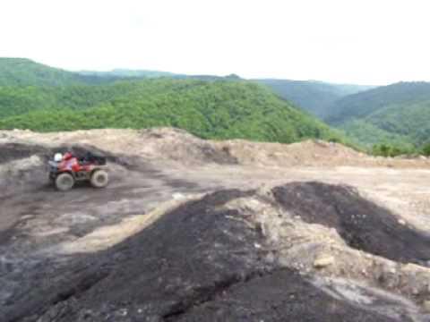 Riding fourwheelers on top of West Va strip mines