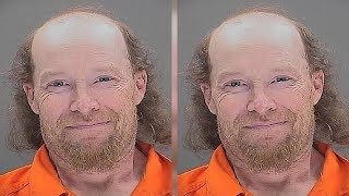 Man accused of killing his own son smiles for police mugshot