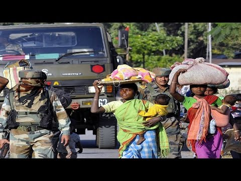 Displaced people in violence-hit Assam start returning home