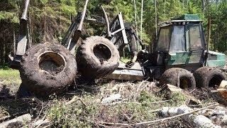 Fully loaded Timberjack 1210 stuck in mud