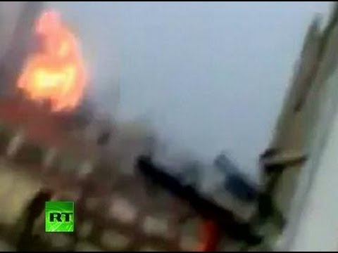 Syria amateur video: Huge blast as troops shell Homs, protesters under fire