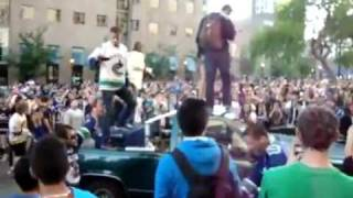 Idiot Hits Girl on Truck Roof with a Ladder at Vancouver Riots