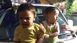 Cute babies playing on car