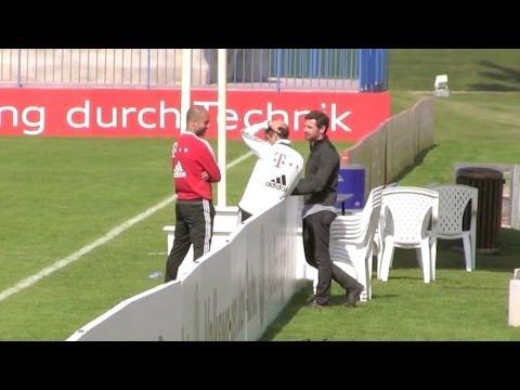 André Villas Boas and Pep Guardiola talking after Bayern Munich Training