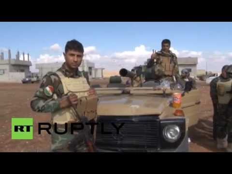 Syria: Iraqi Kurds help defend Kobane from Islamic State militants