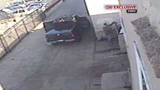 LAPD Manhunt: New Surveillance Video Shows Dorner Dumping Ammo, Military Belt & Helmet in Trash Bin