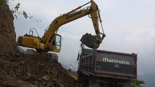 Loading Rock & Earth By Excavator To Dump Truck, Road Construction