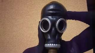 Masking latex mask and russian gas mask over nylon encasement