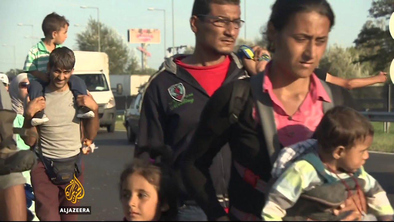 Refugees begin arriving at Hungary-Austria border
