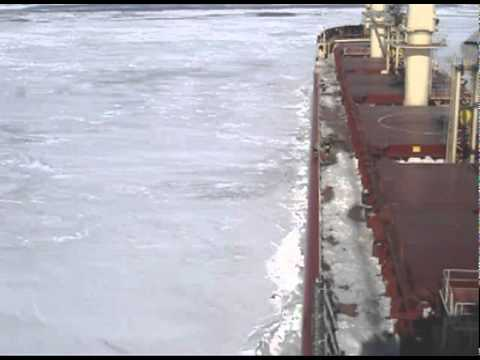Ship cuts through the North Atlantic Ice sheet