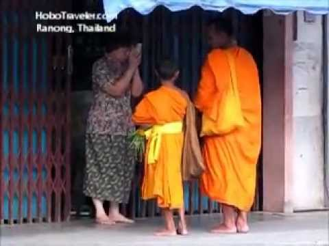 Buddhist Monks in Thailand collecting Morning Offerings