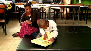 Amazing story of a mother carrying her disabled son to school for about ten years